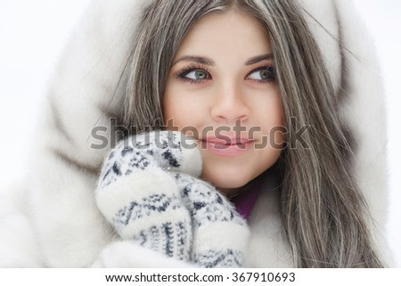 Beautiful winter girl outdoor portrait, smiling woman in fur under snow, happy girl in woolen mittens and fur coat, soft grain instagram filter like, series - stock photo