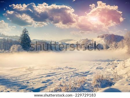 Beautiful winter landscape in the mountain village. Retro style. - stock photo