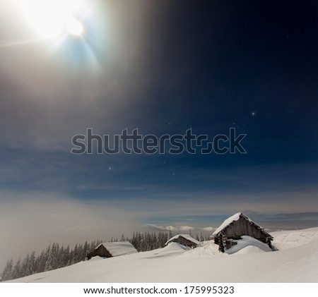 Beautiful winter landscape in the mountains to night with stars and moon - stock photo