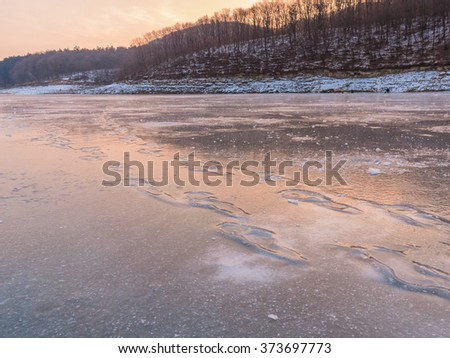 Beautiful winter landscape on the river. River in ice. Winter fishing - stock photo