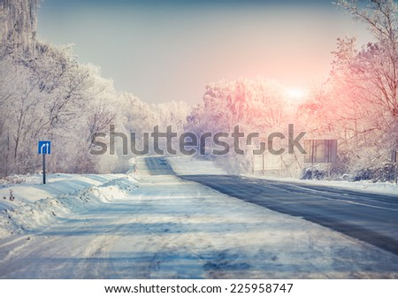Beautiful winter landscape with a highway. Retro style. - stock photo