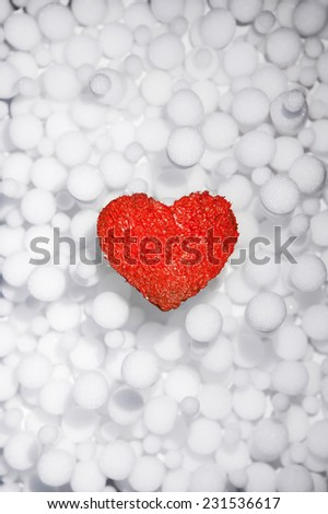 Beautiful winter poster with love red heart. Ice. Snow. Cold. Warm. Merry Christmas. New Year. Valentine's Day. Abstract light snowfall pattern background. - stock photo