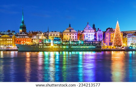 Beautiful winter scenery panorama of the Old Town (Gamla Stan) pier architecture with decorated Xmas Tree in Christmas and New Year holidays in Stockholm, Sweden - stock photo