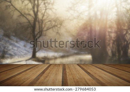 Beautiful Winter snow covered countryside landscape of river flowing with reflections with wooden planks floor - stock photo