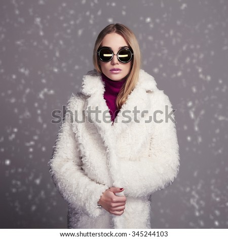 beautiful winter style girl in white fur and sunglasses. fashion beauty young snow woman - stock photo