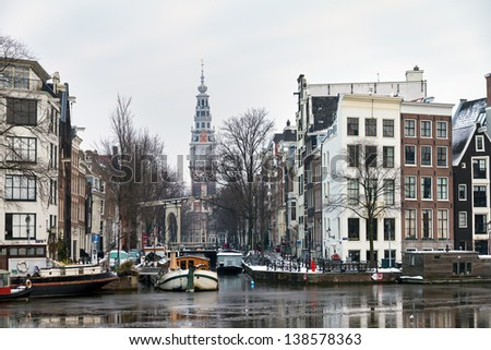 Beautiful winter view on the Groenburgwal and the Southern church in Amsterdam, the Netherlands. - stock photo