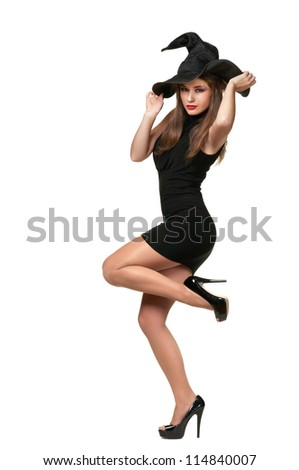 beautiful witch holds a black hat on a white background - stock photo