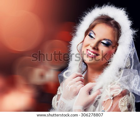 beautiful woman against red colourfu background, Christmas topic - stock photo