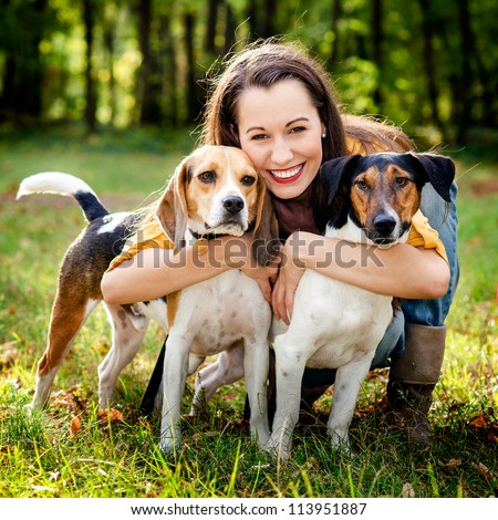 beautiful woman and his dogs posing outside - stock photo