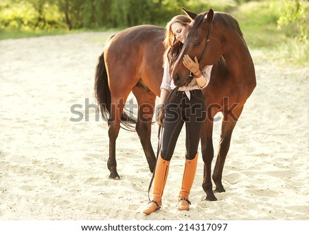 Beautiful woman and horse - stock photo