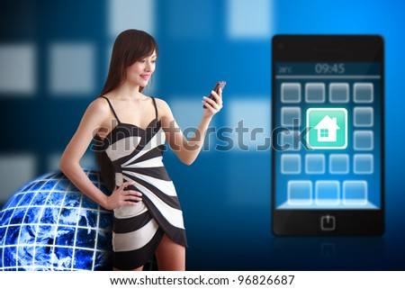 Beautiful woman and house icon on mobile phone : Elements of this image furnished by NASA - stock photo