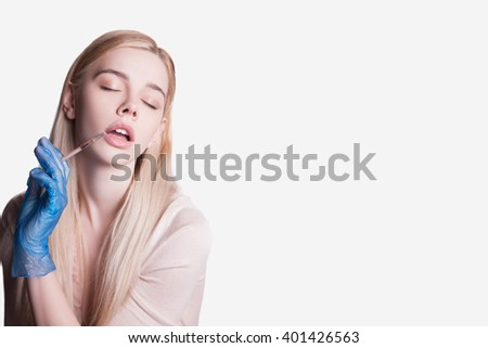 Beautiful woman and injections of youth and beauty, Leather meals, cocktail for the face - stock photo