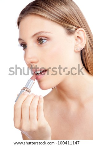 Beautiful woman applying lipstick on lips, isolated on white background. - stock photo
