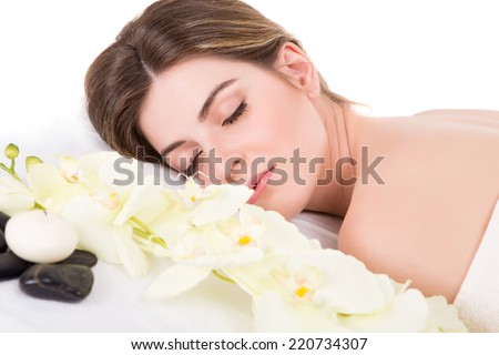 Beautiful woman at beauty center and spa - stock photo