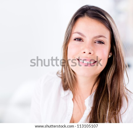 Beautiful woman at home looking very happy - stock photo