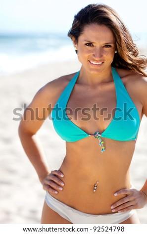 Beautiful woman at the beach wearing a bikini - stock photo