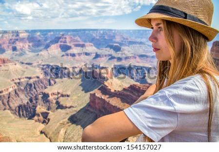 Beautiful woman at the grand canyon - stock photo