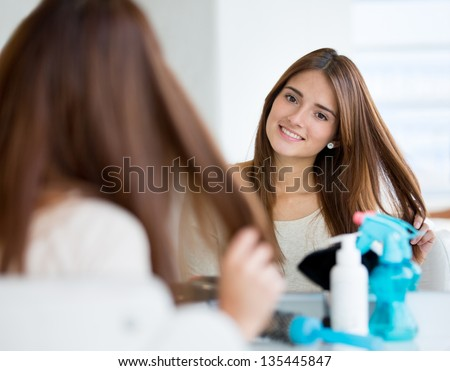Beautiful woman at the hairdresser in need of a haircut - stock photo