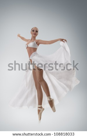 Beautiful woman ballet dancer full length on studio - stock photo