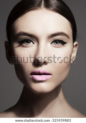 Beautiful Woman. Beauty Glamour Fashion Model Girl Portrait. Perfect Skin and Makeup Natural Make up. Blue eyes and light pink lipstick - stock photo