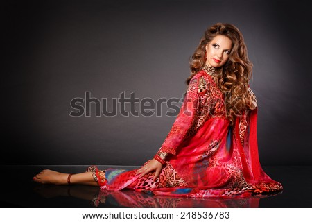 Beautiful woman belly dancer, arabian beauty girl traditional dress, fashionable woman red dress, dancing girl bellydance, professional artist, isolated, studio, series.  - stock photo