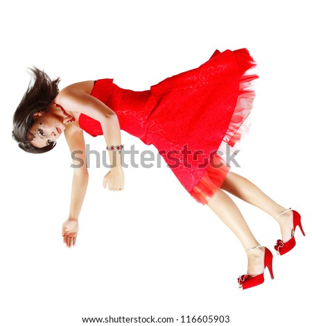 beautiful woman broken doll falling down in red dress isolated on white background - stock photo