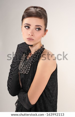 Beautiful woman brunette with gloves in retro style - stock photo
