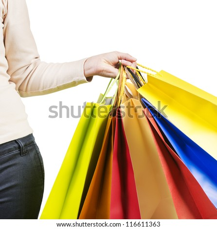 Beautiful woman carrying a lot of colorful shopping bags close up - stock photo