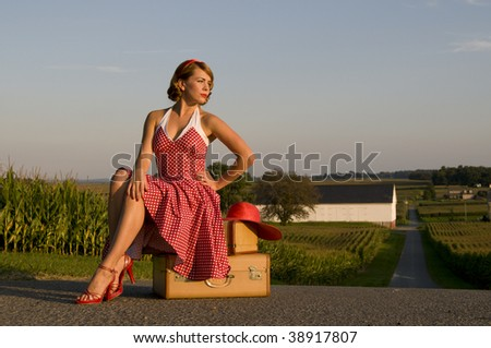 beautiful woman catching a ride in the Pennsylvania country side - stock photo