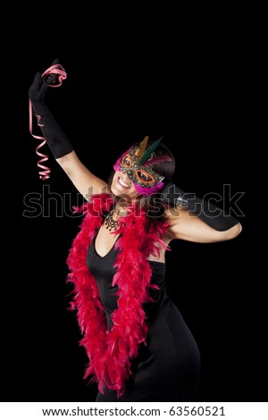 beautiful woman celebrating with a seductive mask (isolated on black) - stock photo