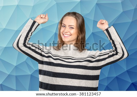 Beautiful woman celebrating with arms up - stock photo