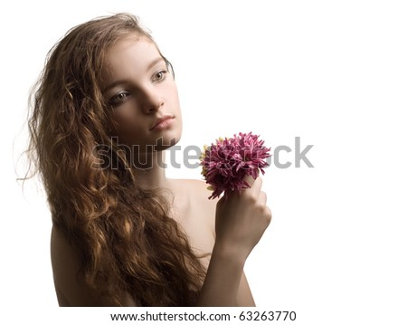 beautiful woman closeup portrait with flower isolated - stock photo
