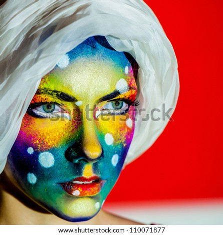 beautiful woman color  face art on red - stock photo
