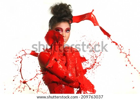 Beautiful Woman Covered in Bright Paint Splatter - stock photo