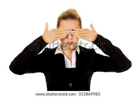 Beautiful woman covering her eyes with her hands. See no evil concept. - stock photo