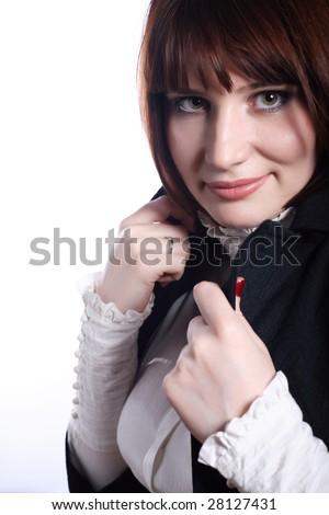 Beautiful woman covering with coat. Fashion. Studio - stock photo