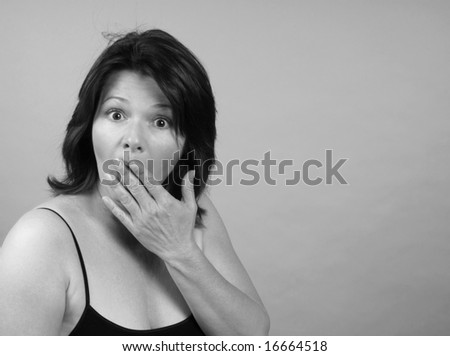 Beautiful woman displaying an expression of shock - stock photo