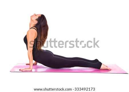 Beautiful woman doing cobra pose on yoga class, Studio shot. - stock photo