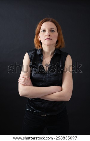 Beautiful woman doing different expressions in different sets of clothes: arms crossed - stock photo