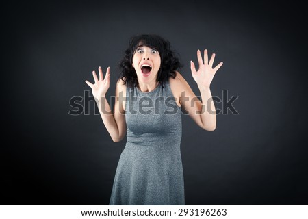 Beautiful woman doing different expressions in different sets of clothes: arms raised - stock photo