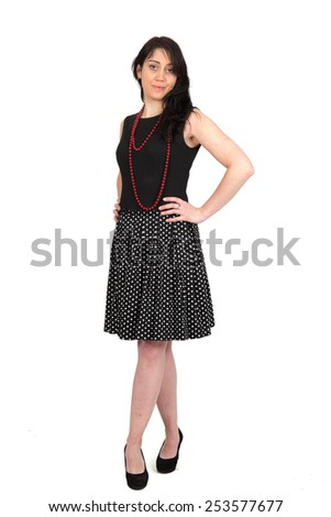 Beautiful woman doing different expressions in different sets of clothes: Full length hands on hips - stock photo
