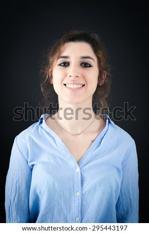 Beautiful woman doing different expressions in different sets of clothes: jsmile - stock photo