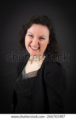 Beautiful woman doing different expressions in different sets of clothes: making a face - stock photo