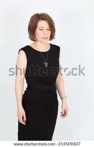 Beautiful woman doing different expressions in different sets of clothes: sad - stock photo