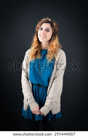 Beautiful woman doing different expressions in different sets of clothes:  smile - stock photo