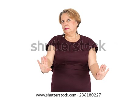 Beautiful woman doing different expressions in different sets of clothes: stop sign - stock photo