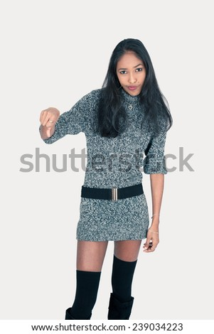 Beautiful woman doing different expressions in different sets of clothes: thumbs down - stock photo
