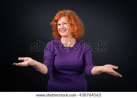 Beautiful woman doing different expressions in different sets of clothes: welcome - stock photo