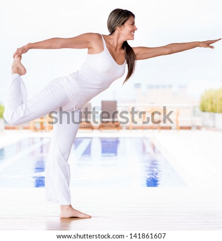 Beautiful woman doing yoga exercises and living a healthy lifestyle - stock photo