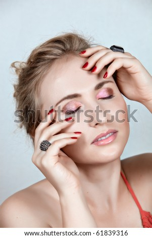 beautiful woman dreaming with hands on her face: eyes closed, not isolated. - stock photo